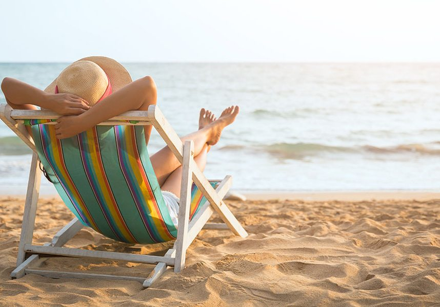 Relaxing on a deckchair on the beach